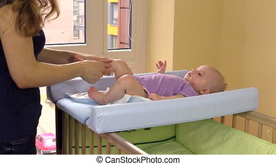 mother massage baby