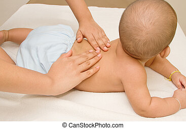 Mother massaging baby, massage back muscle