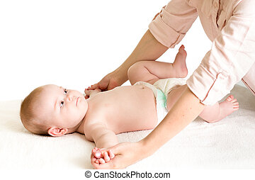 mother massaging baby