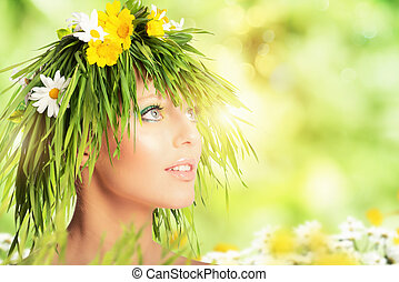 Mother nature beauty concept with girl hair made of flowers and grass.