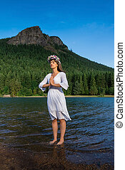 Mother Nature Standing in Water in Front of Mountain