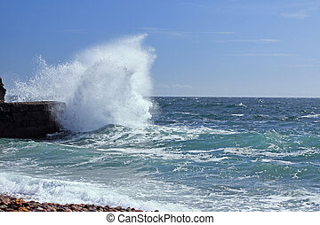 Mother Natures fury - Waves beating against rocks in ...