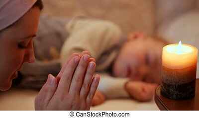 Mother near sleeping baby