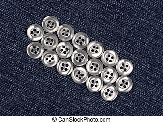 mother-of-pearl buttons on blue fabric