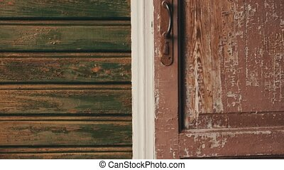 Mother open door walk from country house on street with son....