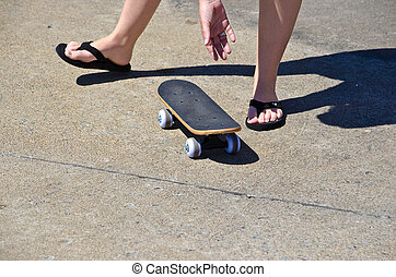 Mother picking up a small skateboard