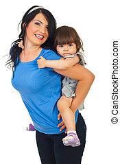 Mother piggyback toddler daughter
