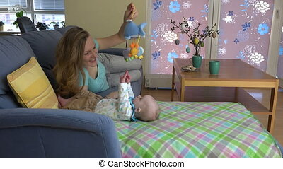 mother play baby sofa