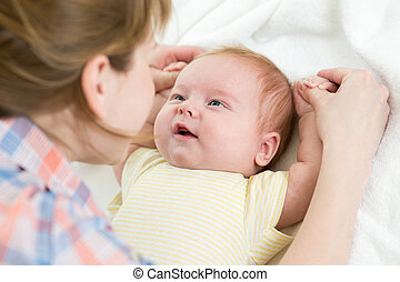 mother playing with baby boy