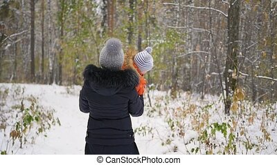 mother playing with baby in winter Park