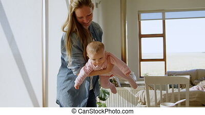 Mother playing with her baby boy 4k
