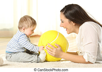 Mother playing with her baby on the floor