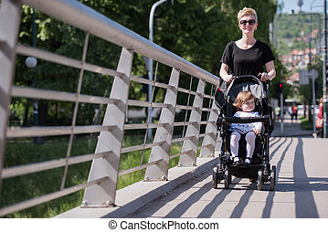mother pushed her baby daughter in a stroller