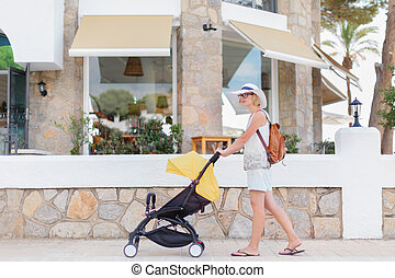 Mother pushing a sleeping baby in stroller