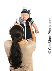 Mother raising baby boy