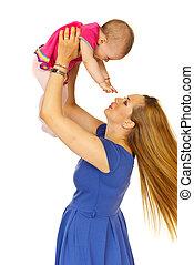 Mother raising baby girl