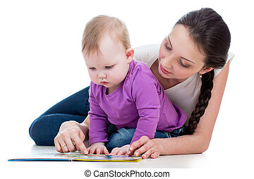 mother reading a book her baby girl