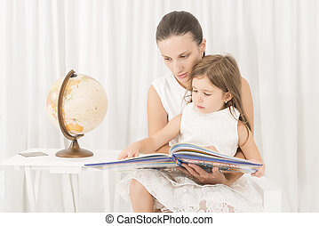 Mother reading a book to her kid