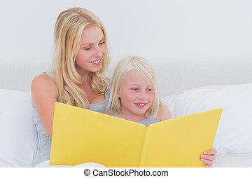 Mother reading a story to her daughter