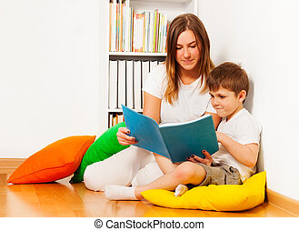 Mother reading a story to her kid son