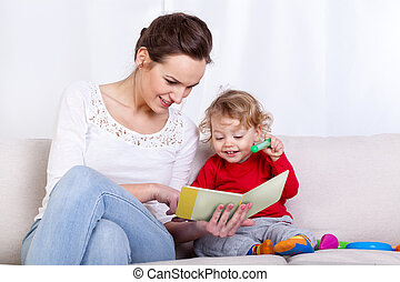 Mother reading book with child