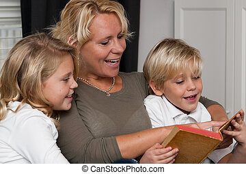 Mother reading to children
