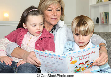 Mother reading to son and daughter