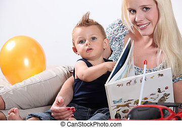 Mother reading to toddler