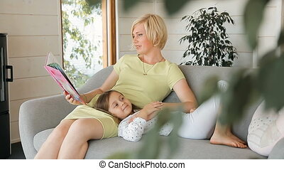 Mother Reads Book to Daughter