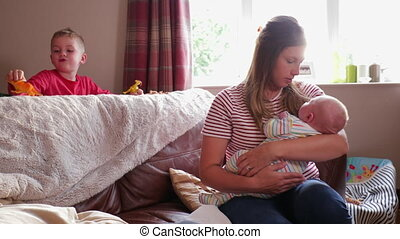 Mother Rocking her Baby Boy