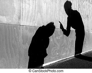 Mother scolds her child outdoors - Shadow on a wall of...