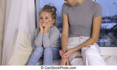 Mother scolds her young daughter