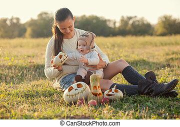 Mother showing baby pumpkin