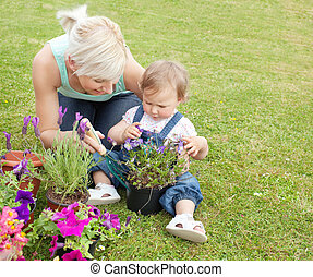 Mother showing her daughter a purple flower