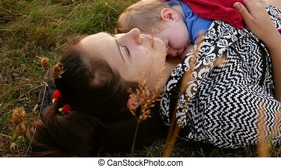 mother sitting with her sleeping daughter