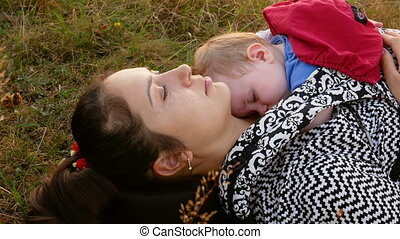 mother sitting with her sleeping daughter - Young mother...