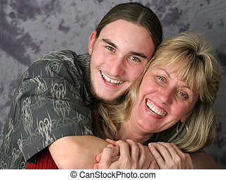 Mother Son Affection - A happy mother and teen son laughing...