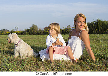 Mother, son and cute dog outdoors
