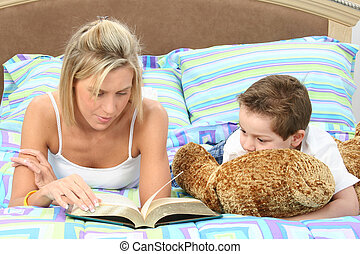 Mother Son Family - Mother and son in pajamas reading book ...