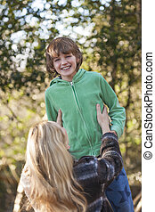 Mother Son Woman Boy Child Laughing Outside in Sunshine
