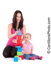 mother son - young mother with son play build blocks