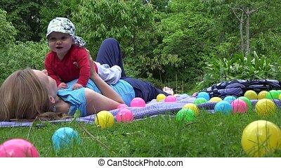 Mother spent leisure time with her newborn baby in garden. 4K