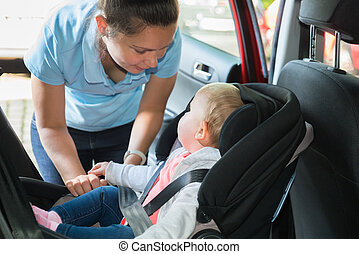 Mother Taking Care Of Her Baby In Car
