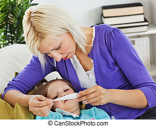 Mother taking care of her sick child