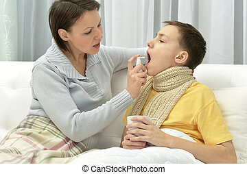 Mother taking care of son