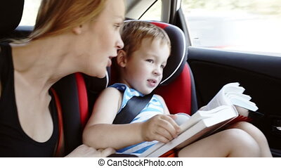 Mother talking to son while they in the car
