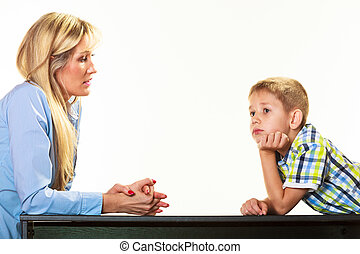 Mother talking with son. Children upbringing.