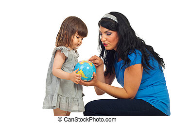 Mother teach daughter about world globe