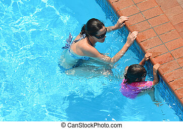 Mother teach her child to swim - Young mother teach her...