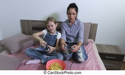 Mother teaches daughter to play computer game